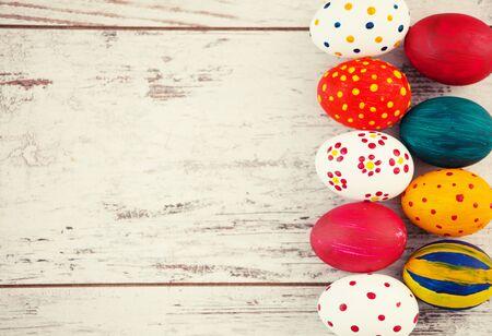 Eggs on wooden old boards. Easter celebration 版權商用圖片