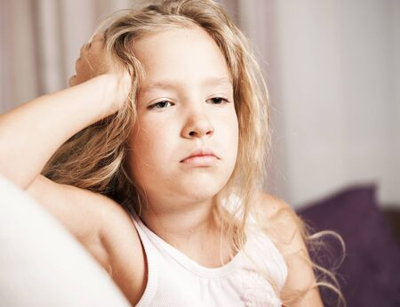 Sad girl at home. Little child stress. Abuse