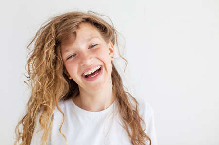 Portrait smiling young girl. Teen at white background