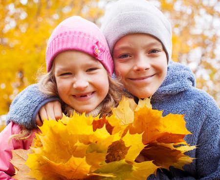 Children at autumn. Girls and boy outdoors