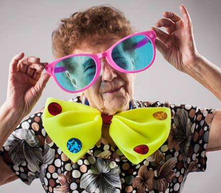 Merry old woman. Happy fun granny. Adult funny female on party Banco de Imagens