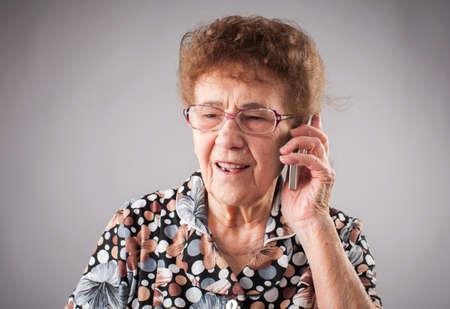 Seniors talking mobile phone. Old adult mature woman