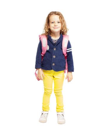Little girl with schoolbag. Happy child on white Standard-Bild