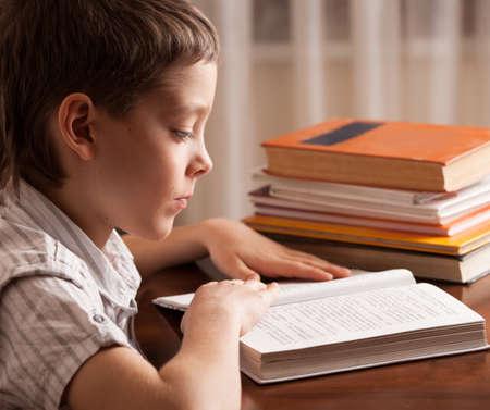 Boy reading book. Child education Zdjęcie Seryjne