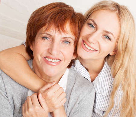 Mother with daughter at home. Portrait family