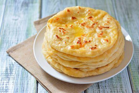 georgian: Georgian khachapuri a flat cake with cheese on a plate