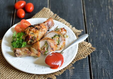 cep: Stuffed chicken drumstick grilled on a plate Stock Photo