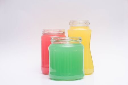 Glass containers with colored liquid Stockfoto