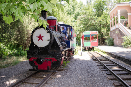 children's: Station with an old steam locomotive in the children s park