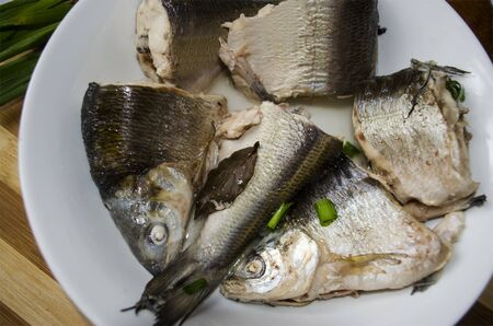 whitefish: Boiled chunks of whitefish and dusted?green?onions?on the plate
