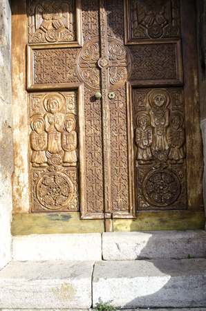 apostolic: Wooden door a cross with carved patterns in the church