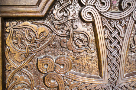 interweaving: Part relief carving of the cross on of the wooden door