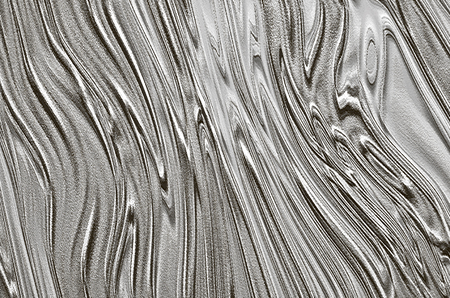 Abstract textured gray background assembled of black and white curves