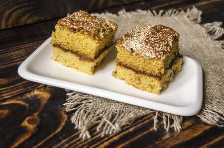 sesame seeds: Two slices of sponge cake with nuts and sesame seeds
