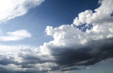 blanketed: Hurricane blanketed�sky dark rain clouds  on a clear sunny day Stock Photo