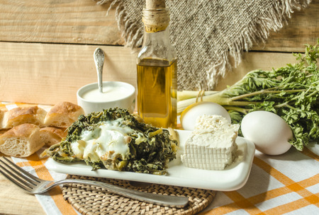 sour milk: The shoots edible spring grass with eggs and sour milk on the rough wooden boards covered with kitchen towel
