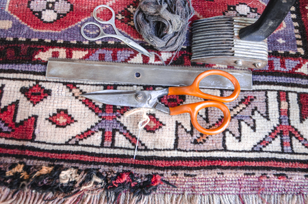 wicker work: Tools for the restoration of the old of worn woolen carpet