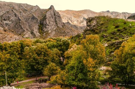 Autumn view of the the mountain village with yellowed walnut landscaped gardens Stock Photo