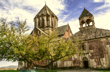 Monastery of St.John the Baptist in Gandzasar and yellowed old tree  at the entrance Stock Photo