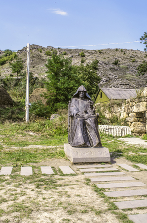 Dilijan, Armenia: The monument to the great Armenian philosopher Mkhitar Gosh in front of the Goshavank monastery in Gosh village, near the town of Dilijan