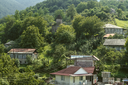 Dilijan, Armenia, View of the mountains covered with forest and the chapel of St. Sarkis in the village of gosh, located near the town of Dilijan