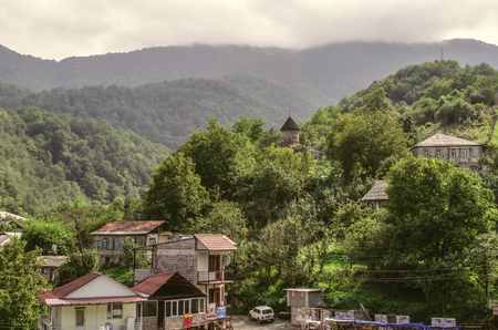 Dilijan, Armenia, Mountain village gosh with houses and chapel of St. Sarkis covered with fog, located in the woods near the town of Dilijan