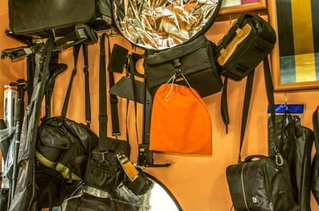 Yerevan, Armenia, September 16, 2015: Room with a collection of different bags for cameras, tripod, reflectors and various accessories for photographers on Mesrop Mashtots Avenue in Yerevan