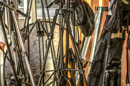 Yerevan, Armenia, September 16, 2015: Bags with straps,various tripod for cameras,reflectors at the window in the shop for photographers on Mesrop Mashtots Avenue in Yerevan Éditoriale