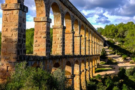 Roman aqueduct. Old stone bridge in Spain Standard-Bild