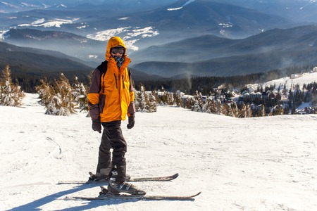 Young guy goes skiing in winter