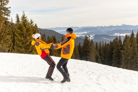Couple in winter mountains