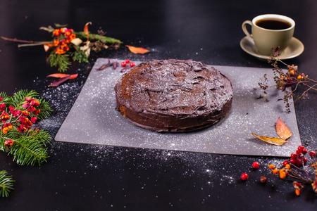 Camera focuses on chocolate pumpkin cake lies on table