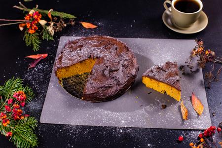 Camera focuses on chocolate pumpkin cake in a cut