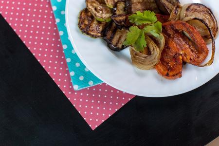 Squash, eggplant, pepper, onion grill and cilantro lie on a white plate Reklamní fotografie