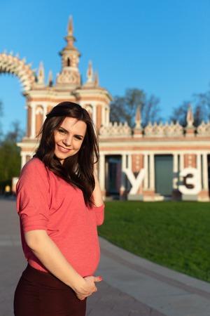 Pregnant girl near castle