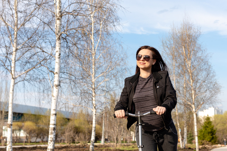 Pregnant girl on scooter Reklamní fotografie