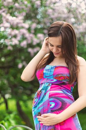 Pregnant girl in dress in lavender garden