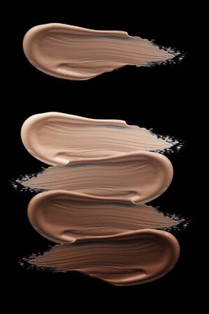 Smudged liquid make-up base isolated on a black background