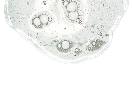 Flüssiges Gel oder Serum auf einem Bildschirm mit weißem isoliertem Hintergrund des Mikroskops Standard-Bild