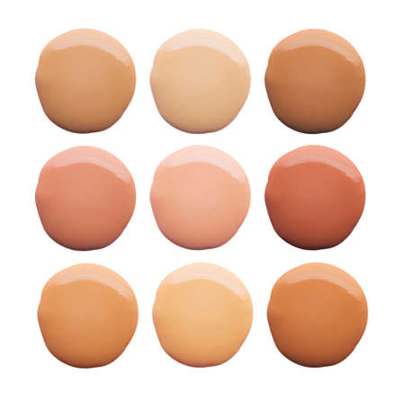 Palette of different shades make up foundation drop smudge texture white isolated background