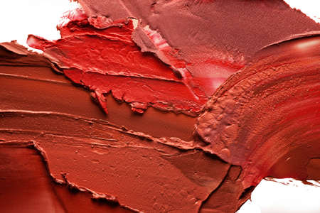 Glossy multi colored lipstick background texture smudged