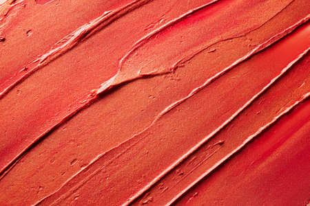 Glossy red lipstick background texture smudged