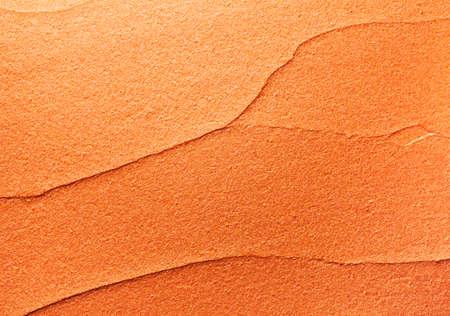 Glossy golden orange lipstick background texture smudged Zdjęcie Seryjne