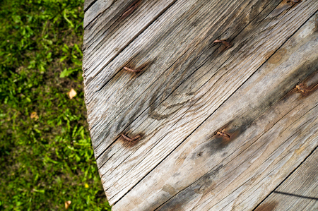 Wooden table in garden Stock Photo