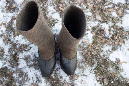Traditional winter footwear in rural areas. Russian work shoes, shoes for the village, ice fishing.
