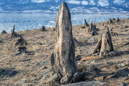 cairns: Group of stones and cairns at frozen lake Baikal background.