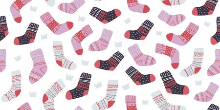 Autumn vector seamless pattern with cute colorful socks on dark background. Funny doodle socks with different patterns. Cute winter and autumn holidays hygge textile design in scandinavian style
