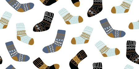 Autumn vector seamless pattern with cute socks on white background. Funny doodle socks with different patterns. Cute winter and autumn holidays hygge textile design in scandinavian style