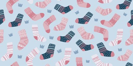 Autumn vector seamless pattern with cute pink socks on light blue background with crowns. Funny doodle socks. Cute winter and autumn holidays hygge textile design in scandinavian style