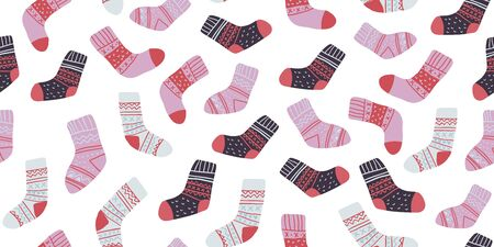 Autumn vector seamless pattern with cute colorful socks on white. Funny doodle socks with different patterns. Cute winter and autumn holidays hygge textile design in scandinavian style